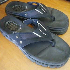 Black Skechers rubber wedge sandals